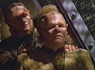 [Neelix and Wix watch as Chakotay and Paris are arrested for their crime]